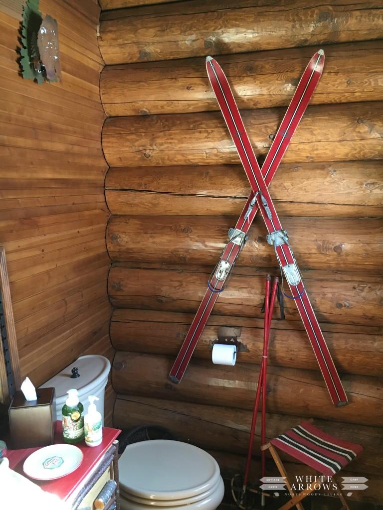 log cabin, guest bath, red skis