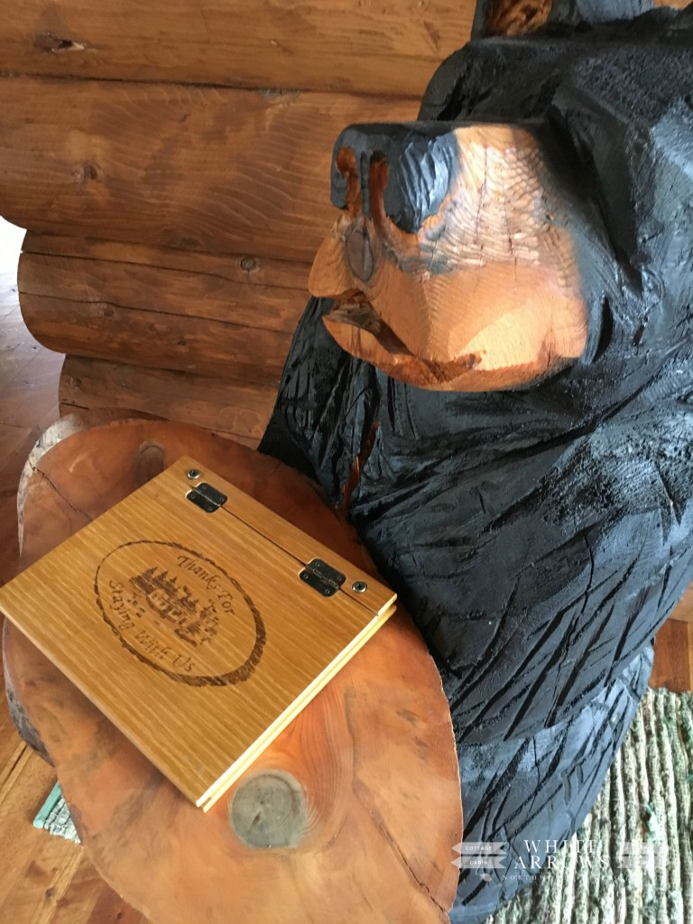 guest book, log home, carved bear