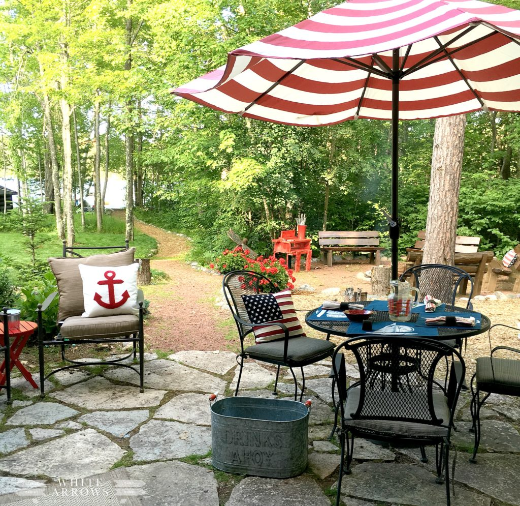 lake house, lake life, patio, red umbrella, anchor pillow, fire pit,