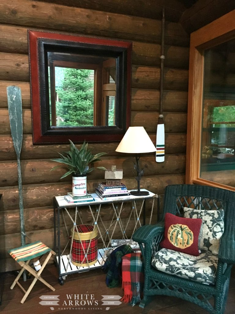 Log Home, cabin style, lake house, paddles and oars, scotch cooler, whicker rocker, camp style, screened in porch, paddles, oars, vintage