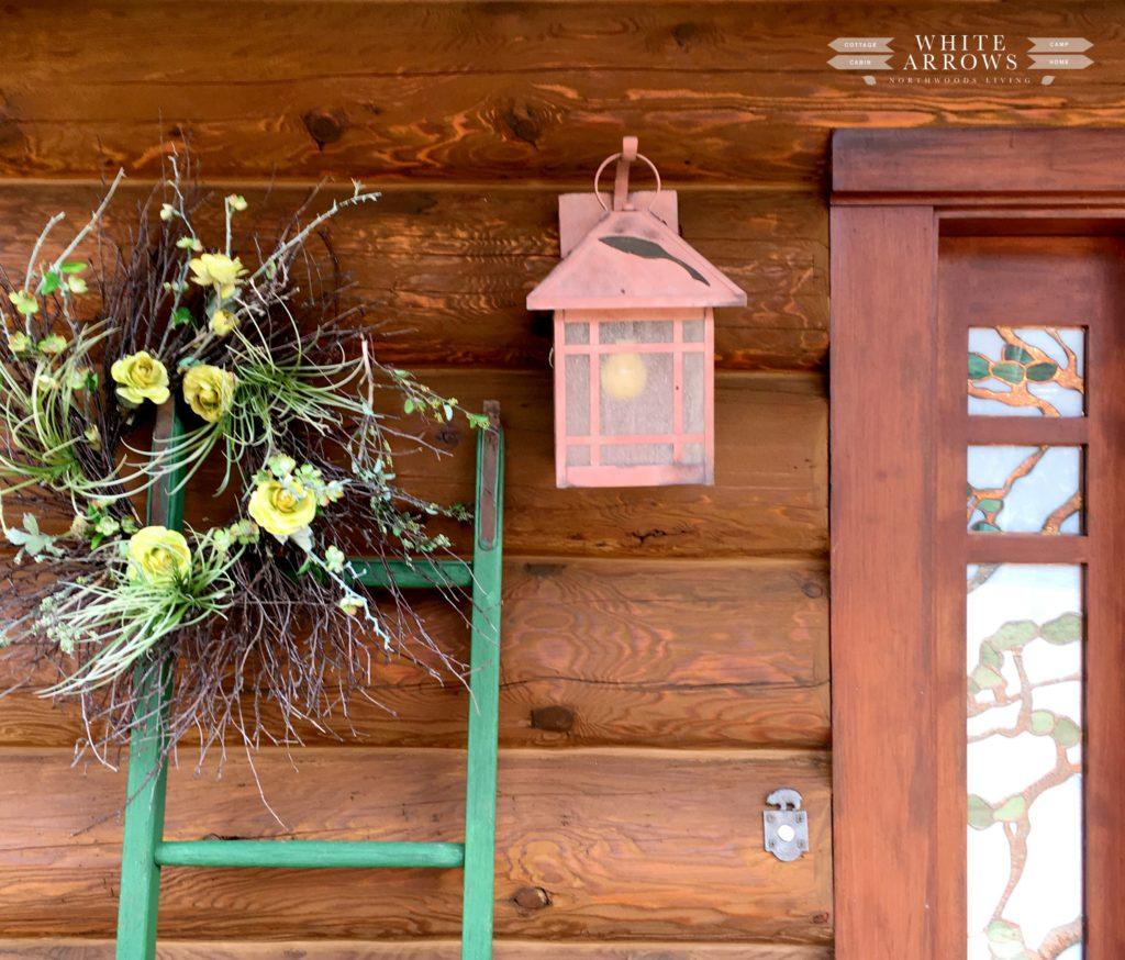 flower wreath, twig wreath, log cabin, rustic sconce, outdoor lighting, cabin, rustic ladder