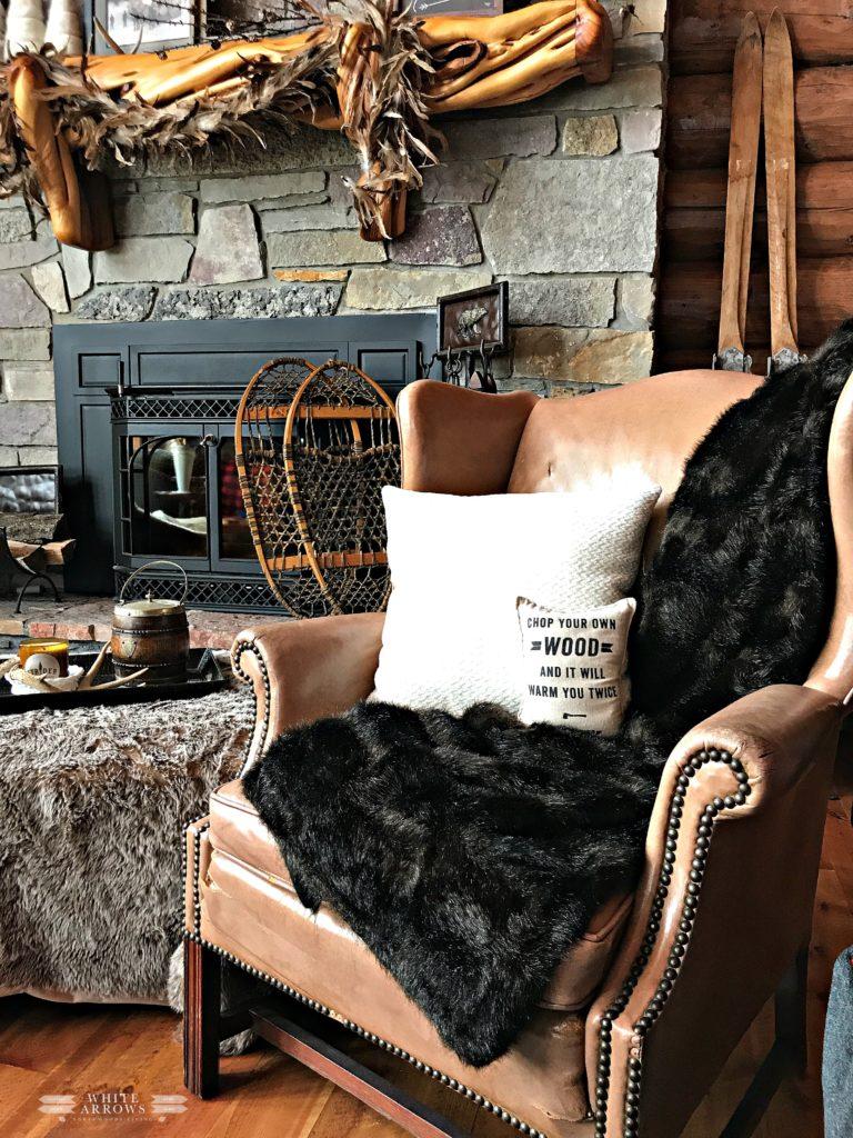 log cabin, cabin decor, rustic decor, winter neutral decor, cozy reading corner, vintage books, neutral decor, winter decor, cozy corner,leather chair, fur throw, snowshoes