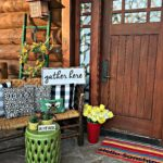 Front Porch, Spring Decor, Spring Porch, Log Cabin, Cabin, McCoy Pottery, Garden Stool, Stained Glass, Porch Lighting