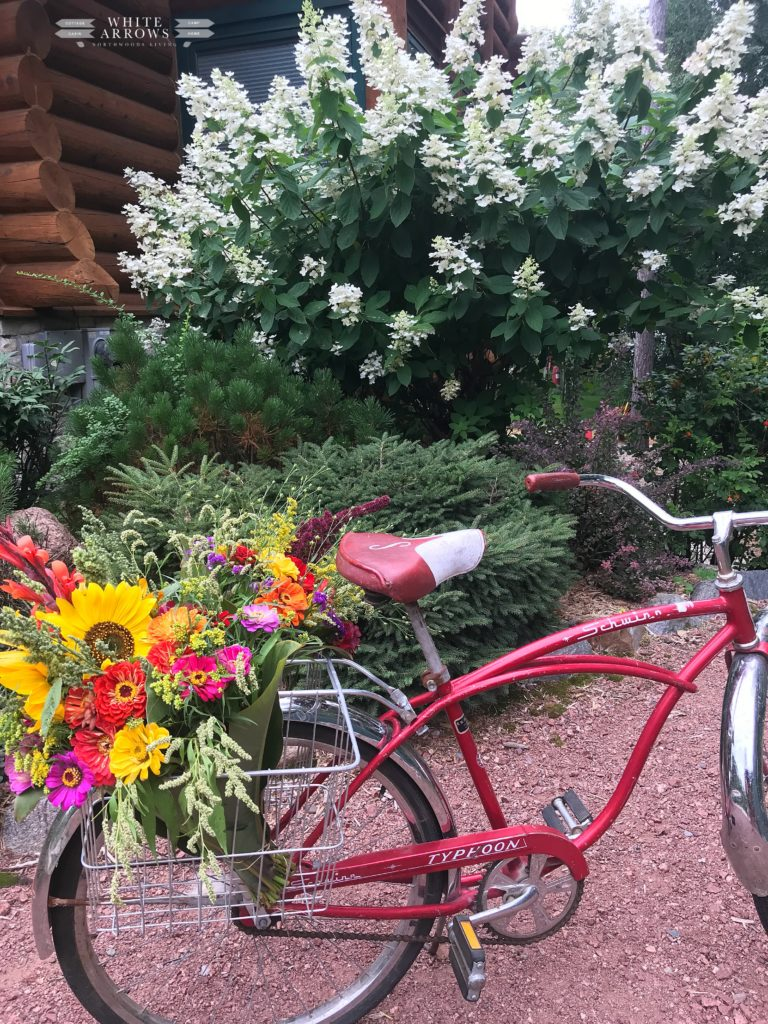 cabin, buffalo plaid, summer to fall decor, summer decor, autumn decor, Summer to Fall Porch Decor, farmer's market flowers, vintage bike