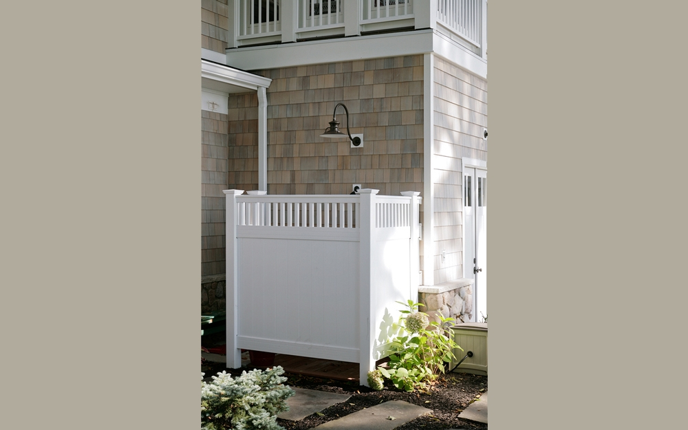 Outdoor Shower with White privacy fencing