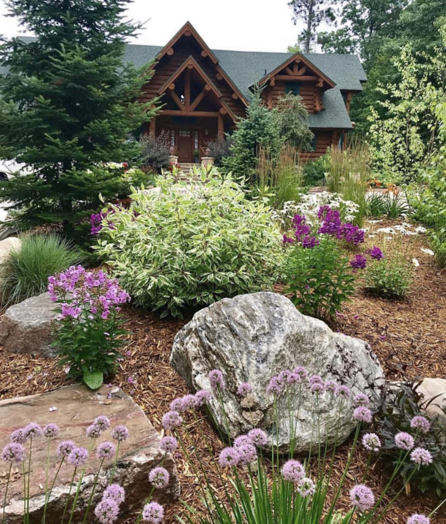 Log Cabin in Minocqua, WI with Summer Flowers