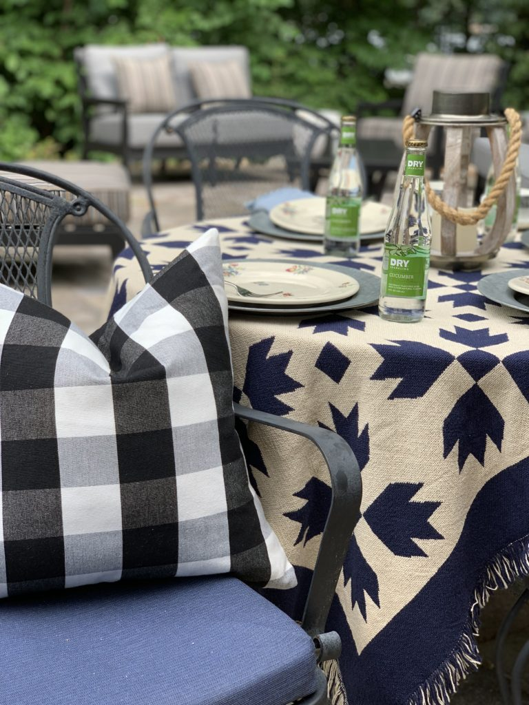 Summer outdoor tablescape with buffalo plaid pillow