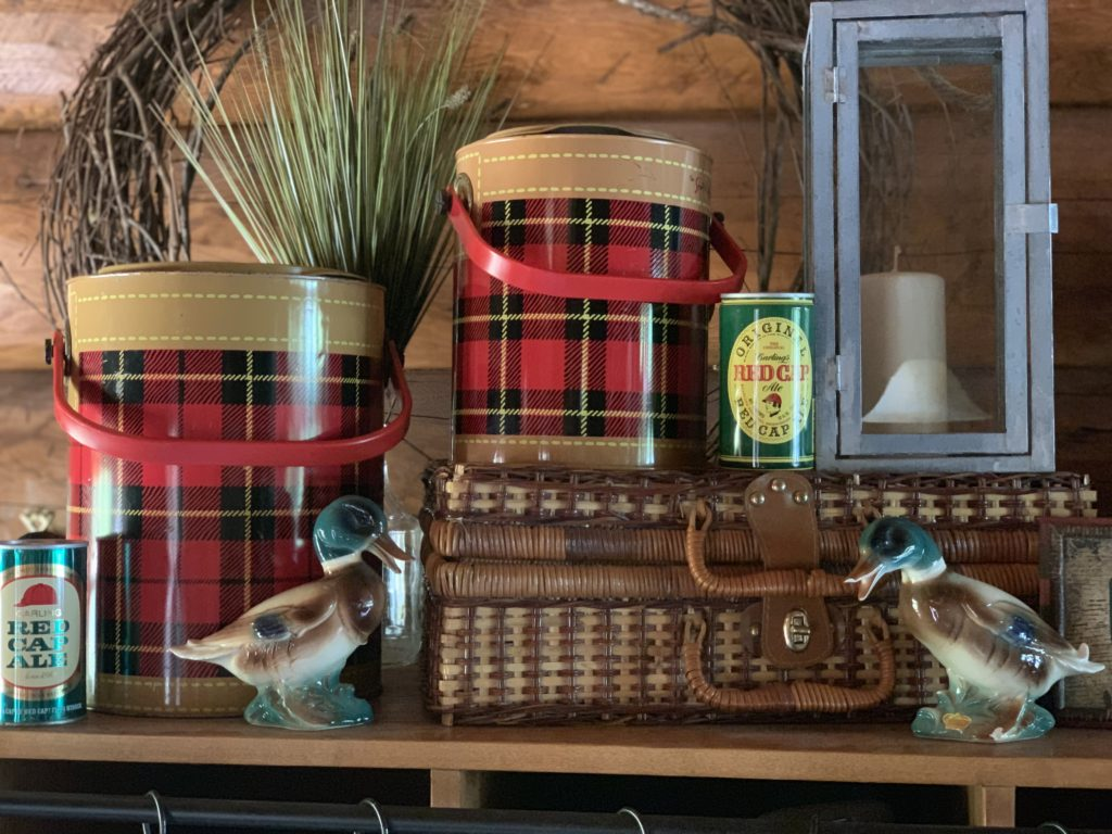 Scotch Plaid coolers and Mallard ducks are fall decor on top of entry way cubbies