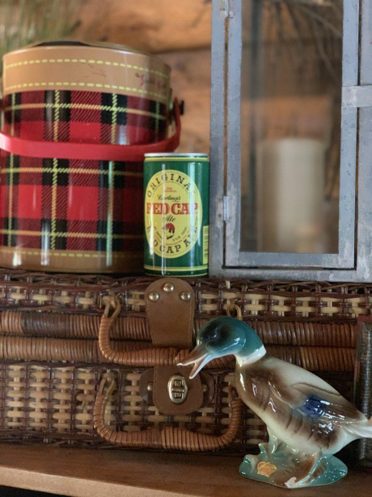 Fall Decor- Woven picnic basket, ceramic mallard duck, vintage red cap beer can