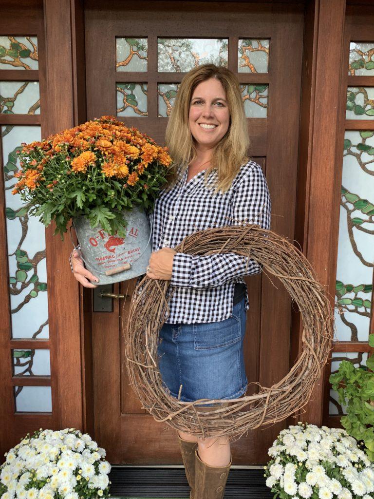 Kristin Lenz decorating her log cabin for Fall