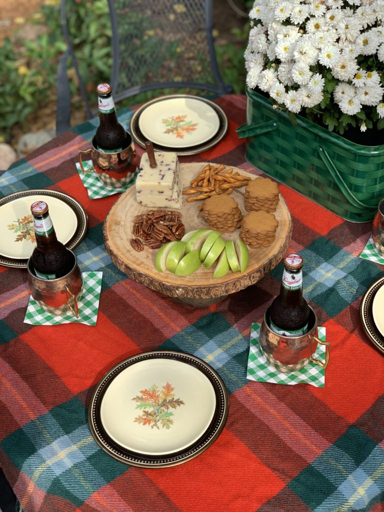 fall outside table set with plaid and copper