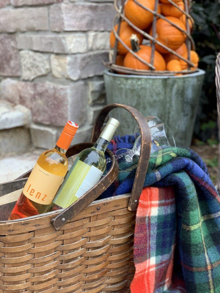 bottles of wine in a woven basket
