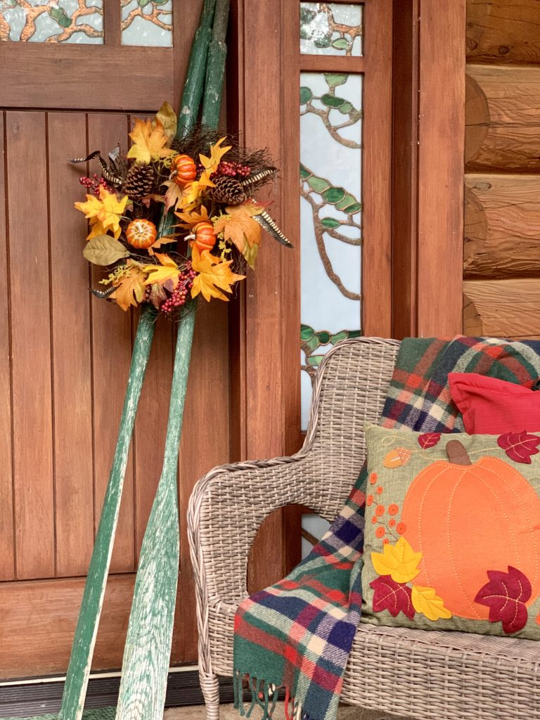 Fall Porch at Lake House Cabin Oars hold a wreath