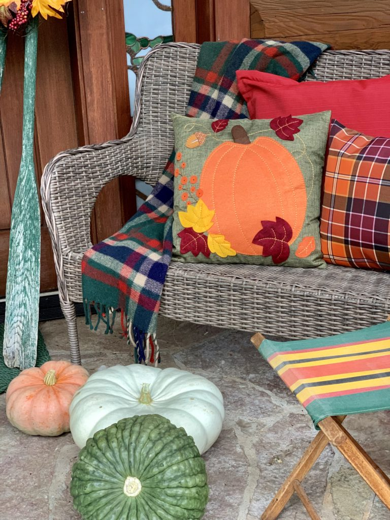 Fall porch with vintage camp stool