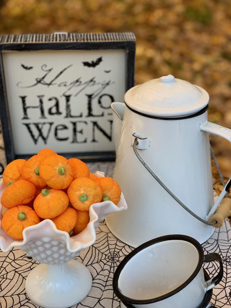 Enamelware coffeepot and mugs with pumpkin marshmallows