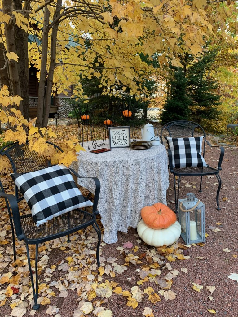 Table Decorated for Halloween Outside under tree with yellow leaves