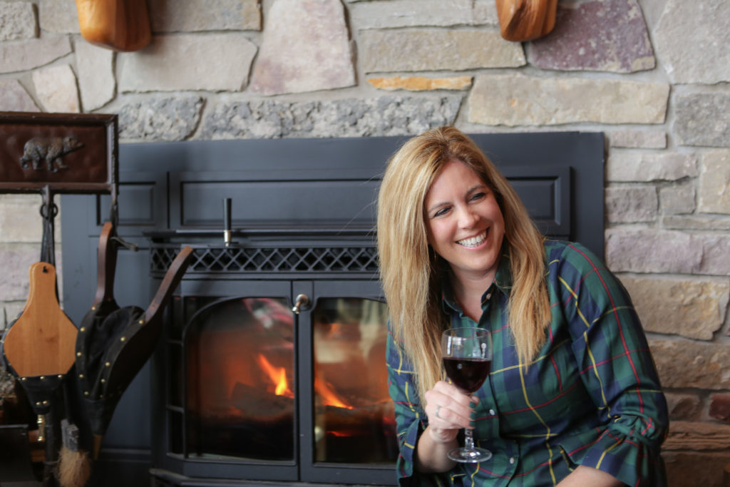 Kristin Lenz by the fireplace