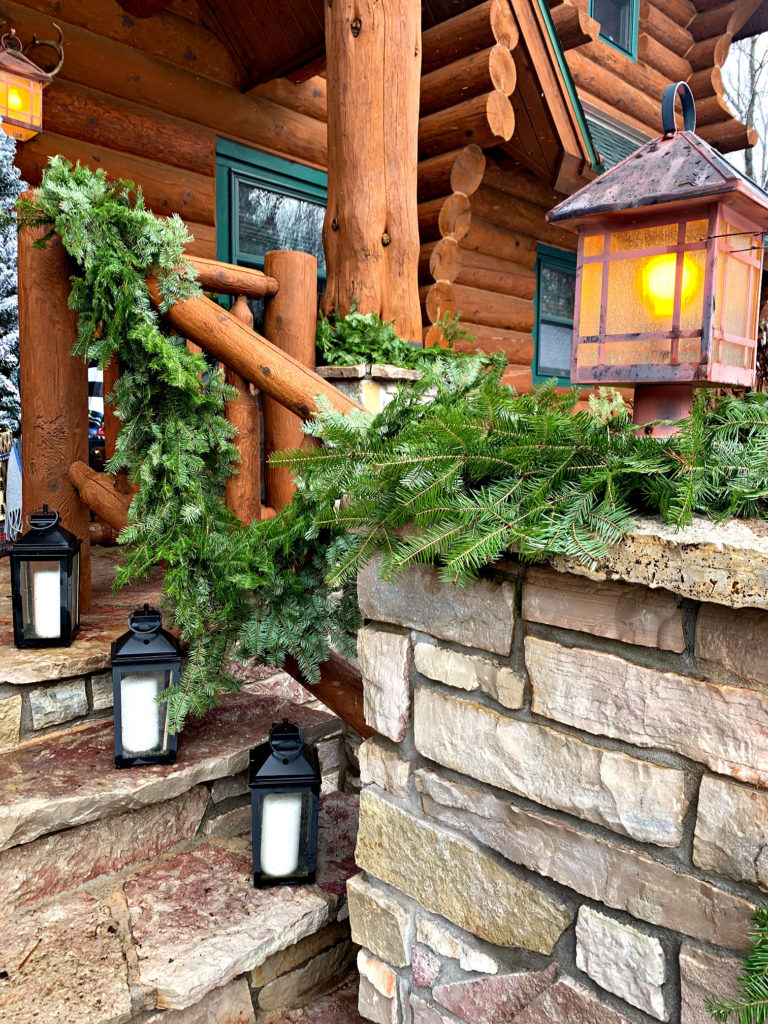 fresh Christmas greens roping porch