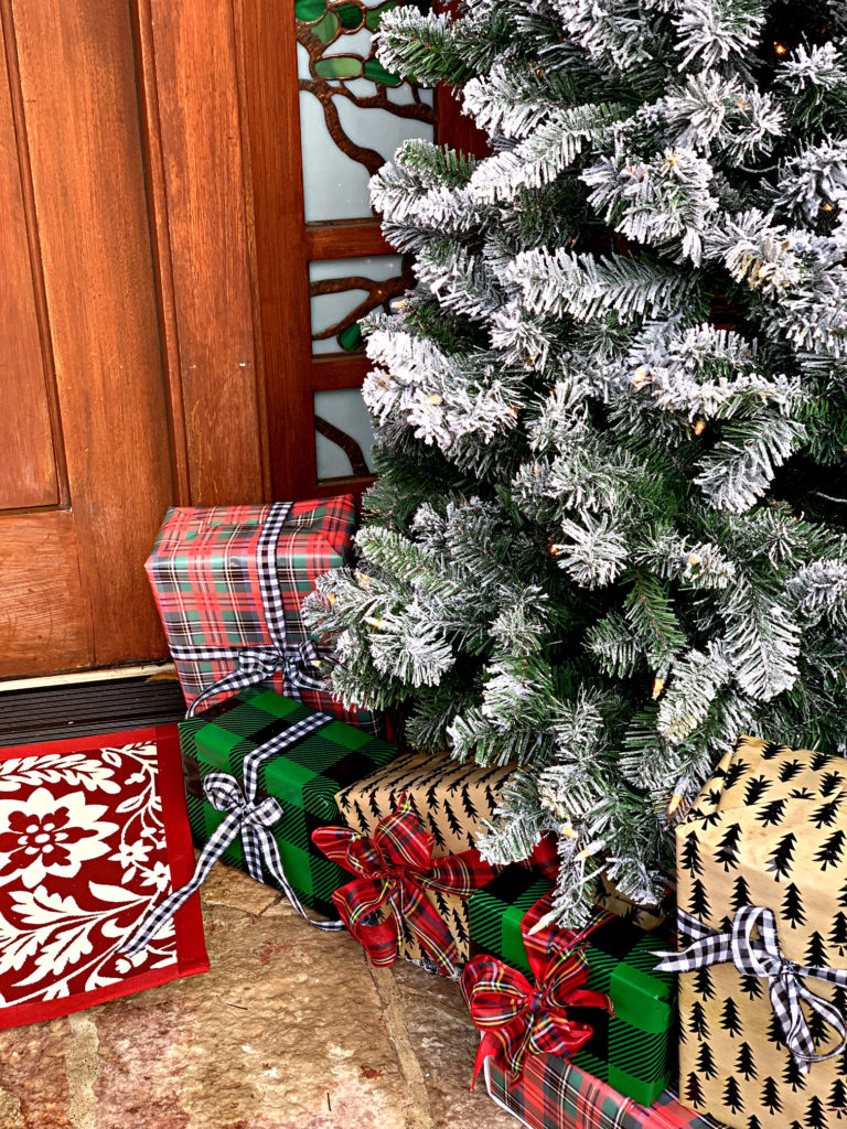 Porch decor wrapped presents under flocked tree
