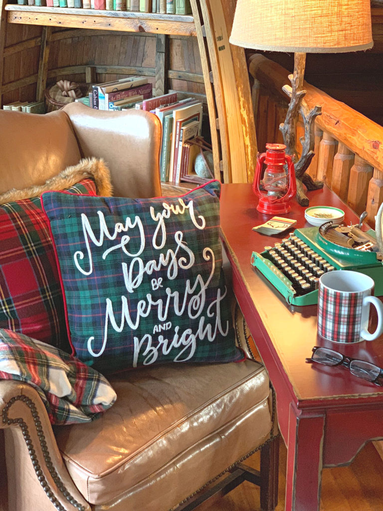 Christmas desk with leather chair plaid throw pillows and vintage typewriter