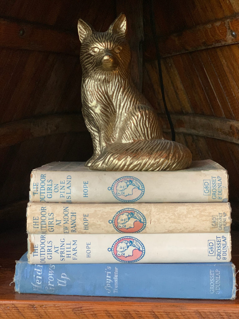 Fox Statue on Vintage Book Stack