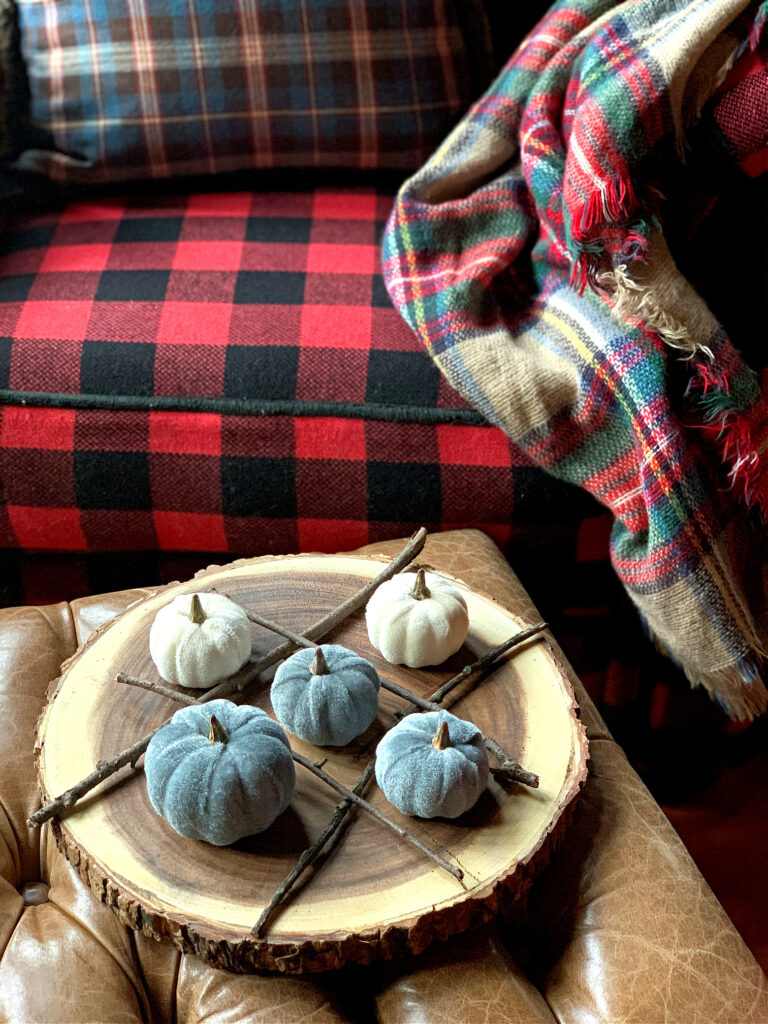 Tic Tac Toe Board Homemade with sticks, velvet pumpkins in cabin