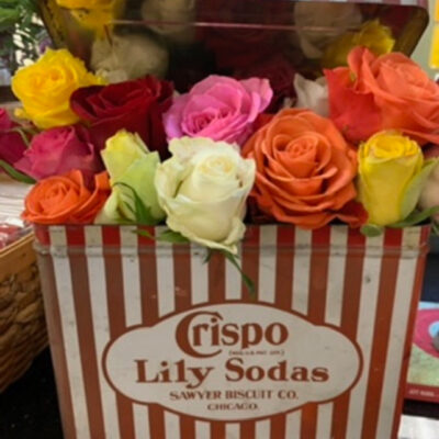 Flower Arrangements in Vintage Containers