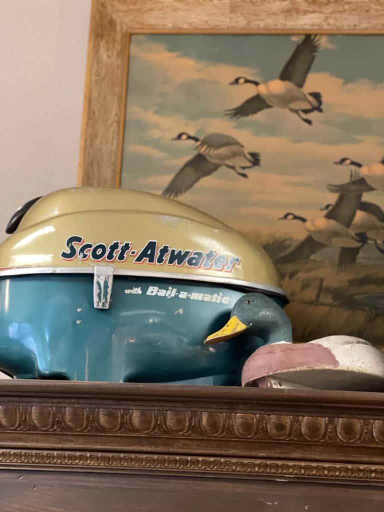 Vintage boat motor, artwork and duck decoy