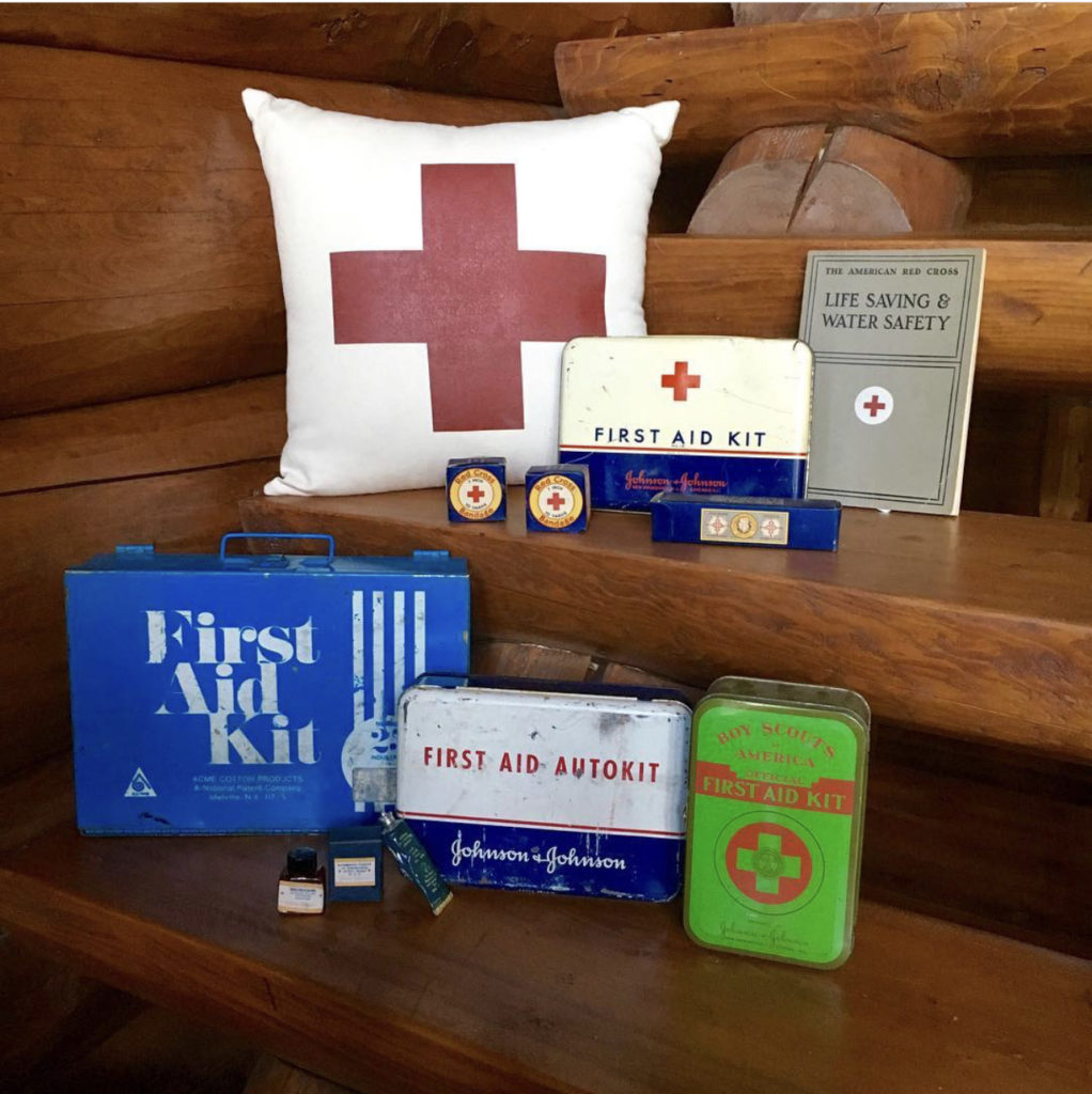 vintage first aid kits, red cross pillow, life saving red cross books