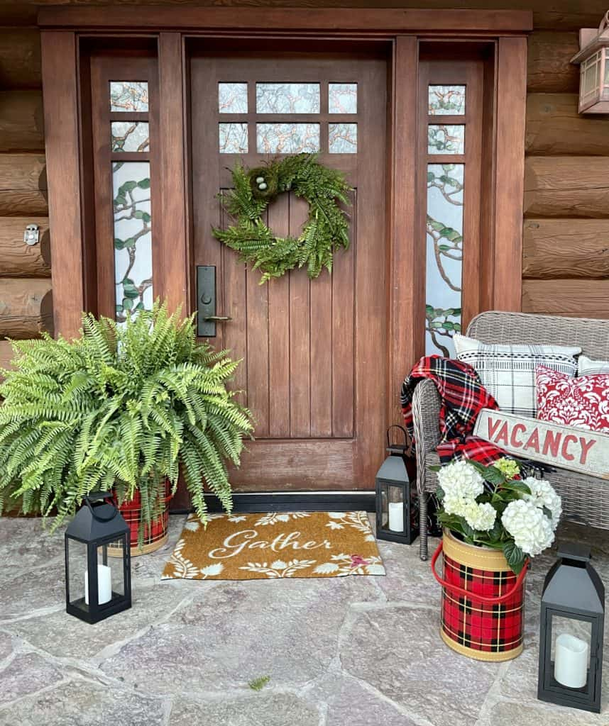 Summer porch decor with ferns and hydrangeas.