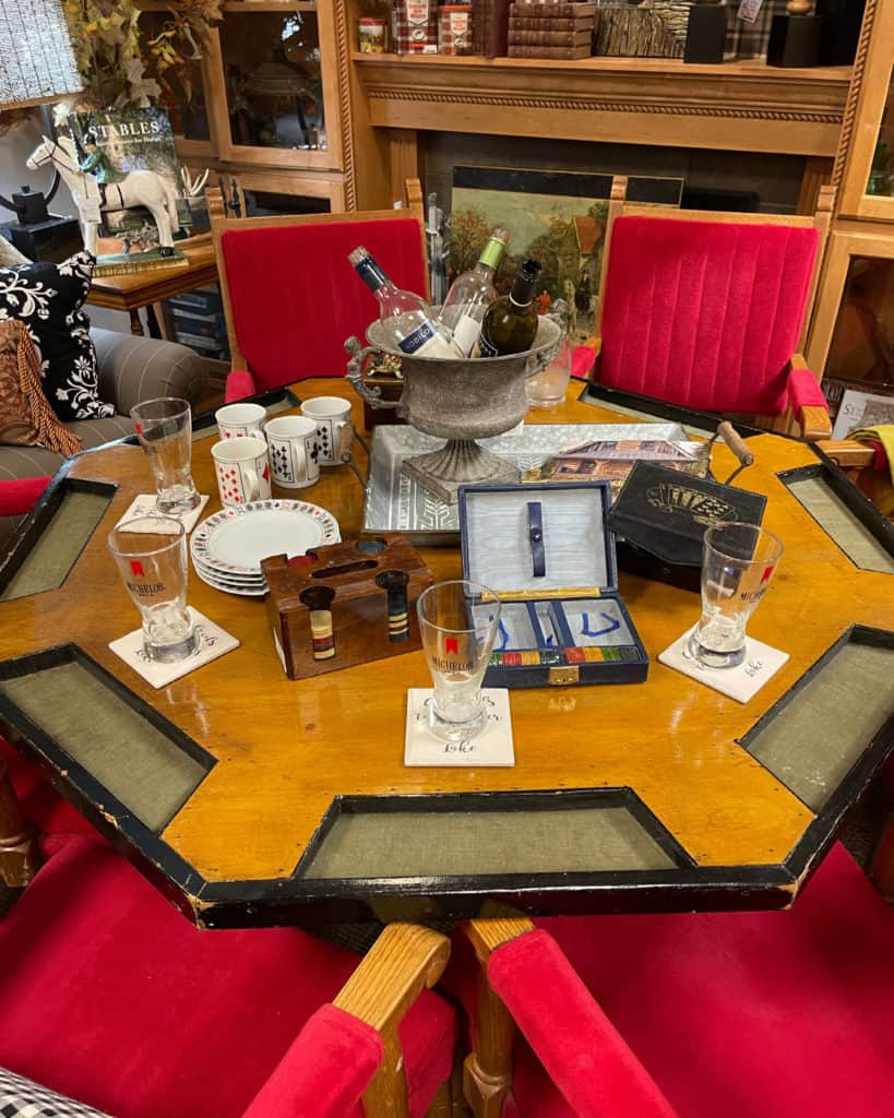 Antique Poker Table with velvet chairs from White Arrows Home