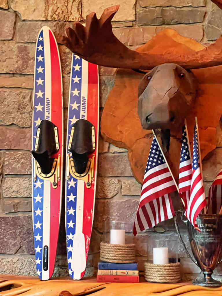 Cabin Summer Mantel Decor with vintage water skis and flags