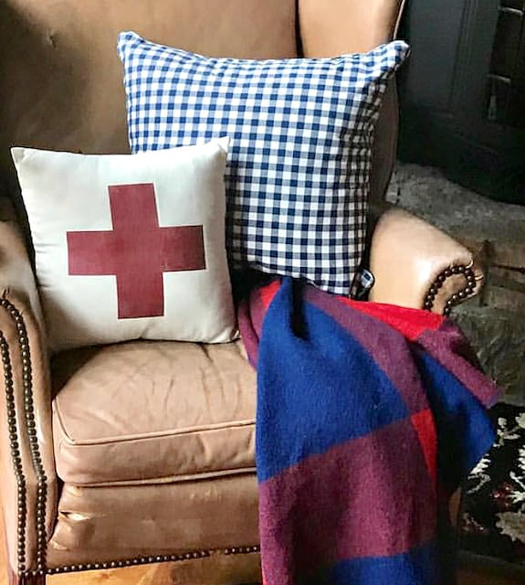 Nautical Decor chair with gingham and swiss cross pillows and blanket