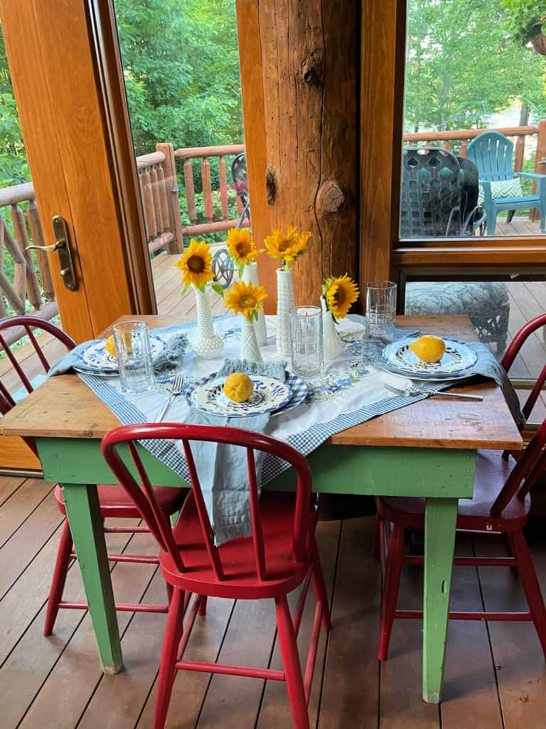 Sunroom Table set for Summer with blue and whites, vintage linens and lemons