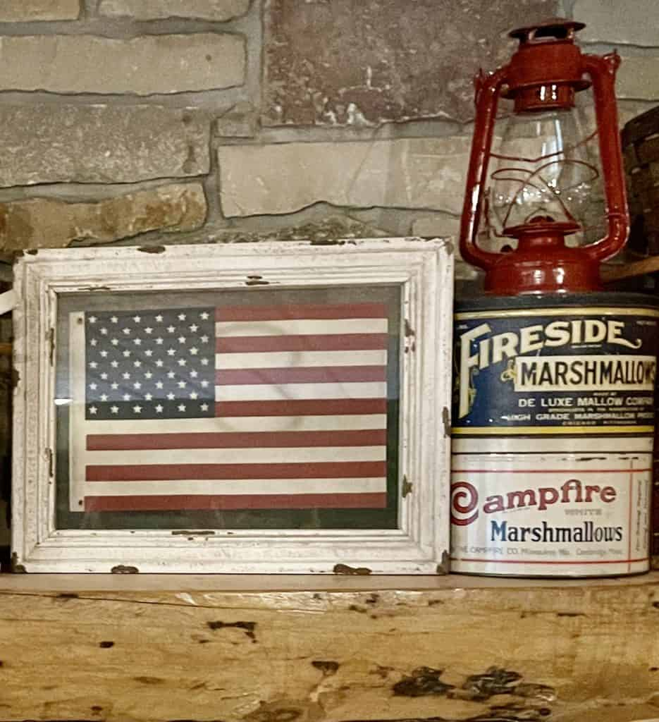 Cabin Mantel Decor with Vintage picnic baskets, lanterns and flags